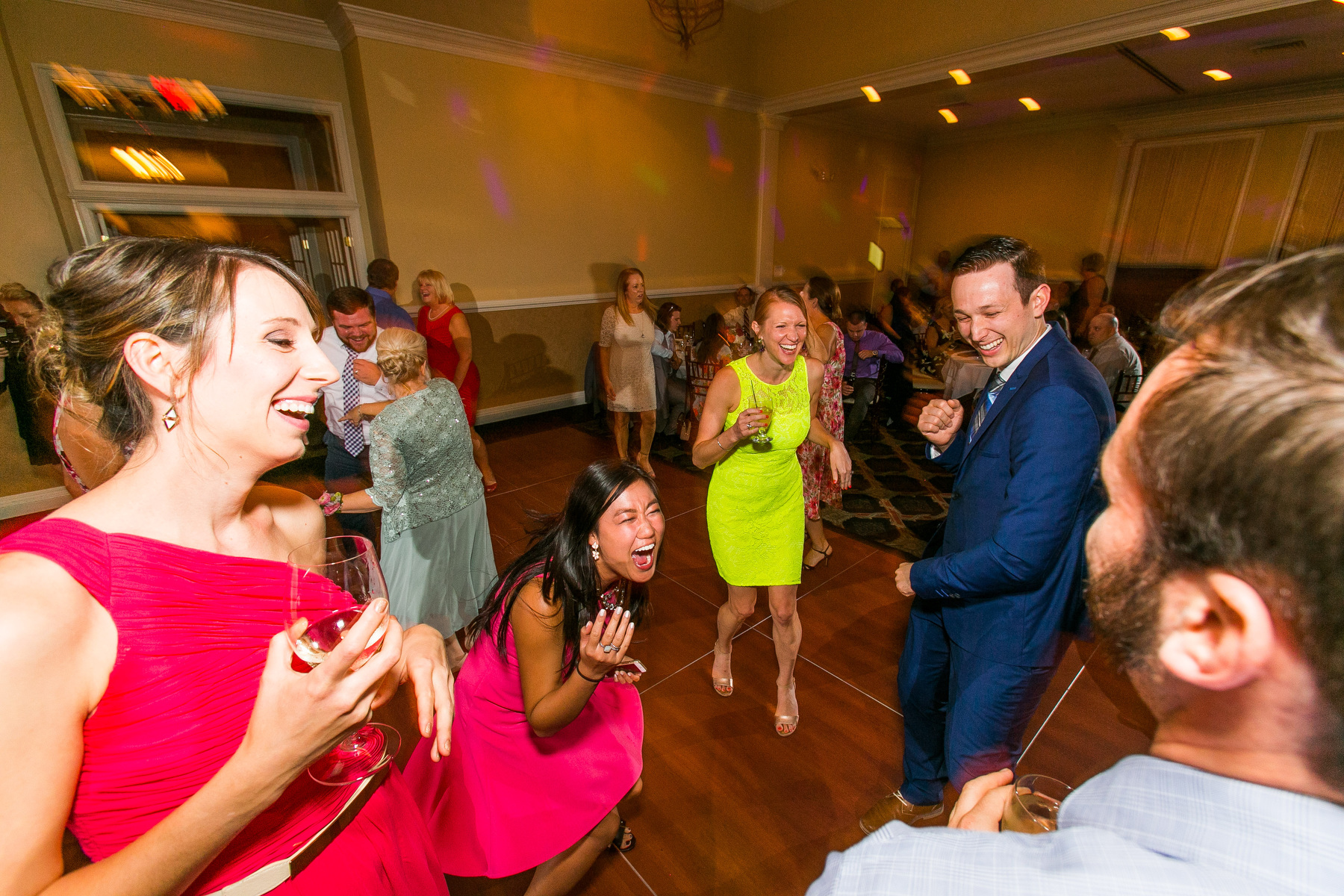 Weddng guests dance at a wedding at The Piedmont Club in Haymarket, VA