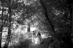 A bride and groom walk down a natural path just before their wedding in Maymont Park in Richmond, Va.
