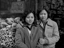 Zee Ying Chan Wong with her daughter Lina Wong, in front of their grocery store, Catherine St., NYC, 1981.