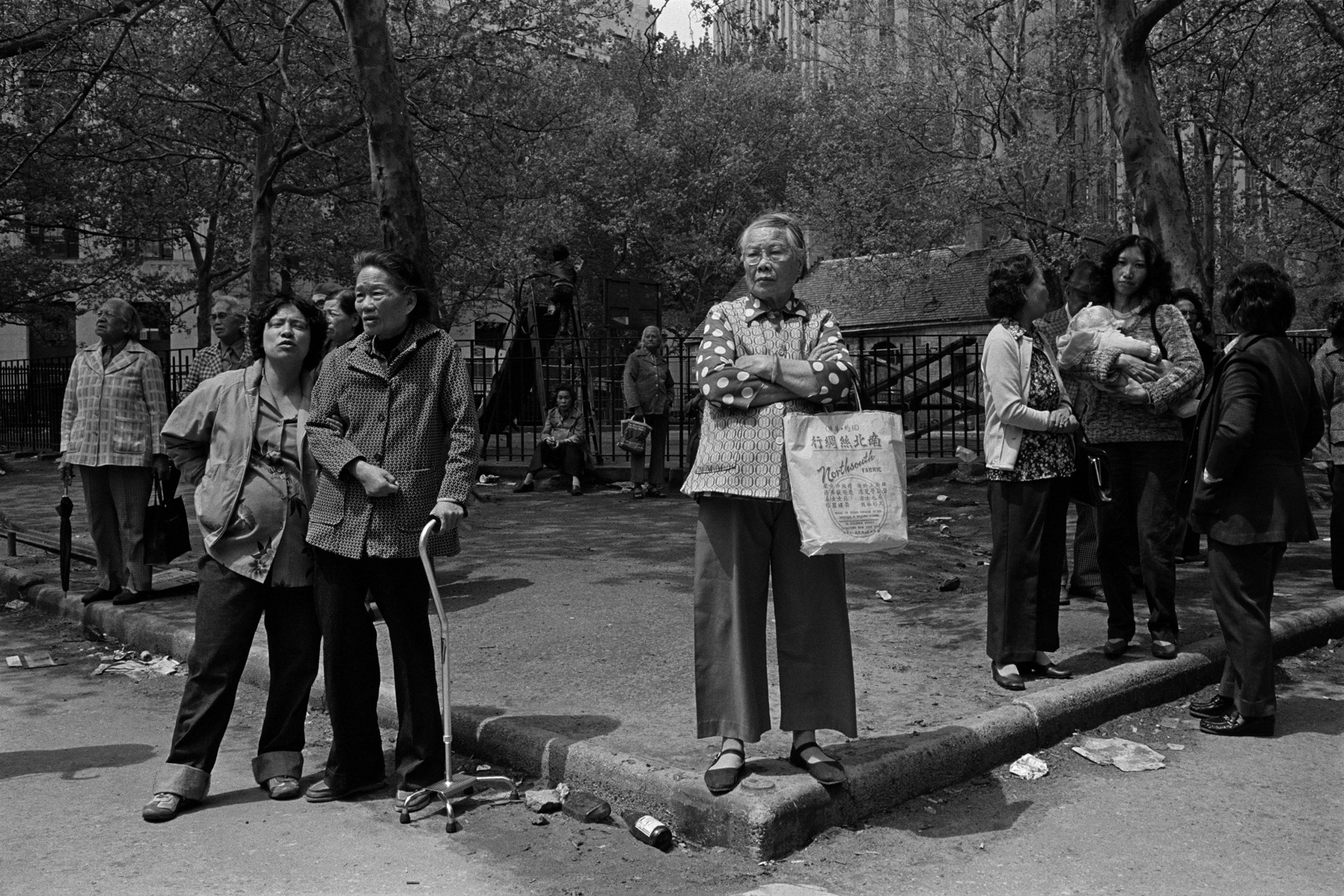 Columbus Park, New York Chinatown,1983.The women in this photograph were watching the funeral proceedings depicted in the previous photograph, directly across the street.