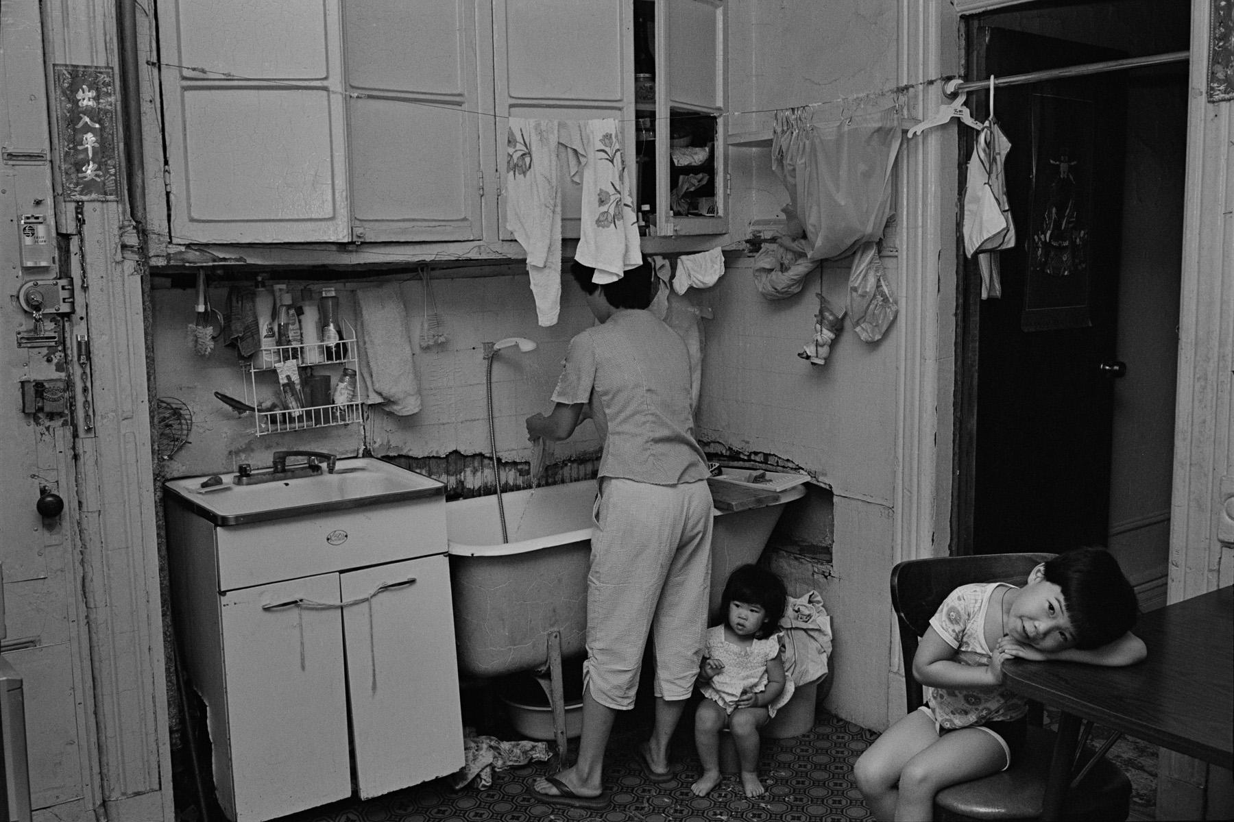 Rebecca with her children in their kitchen, New York Chinatown, 1982