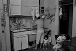 Rebecca with her children in their kitchen, New York Chinatown, 1982