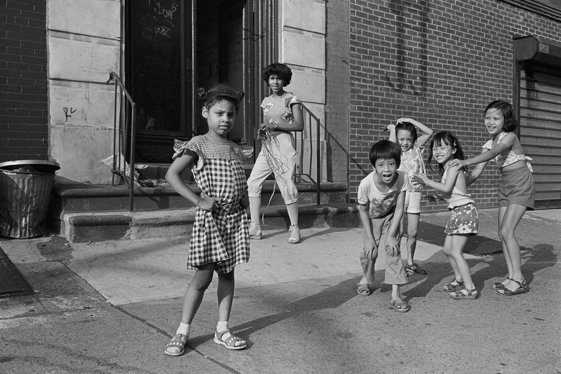 In front of 41 Kenmare St, New York City, 1982.The children in the photograph, now in their 40s, all grew up in 41 Kenmare and still keep in touch.