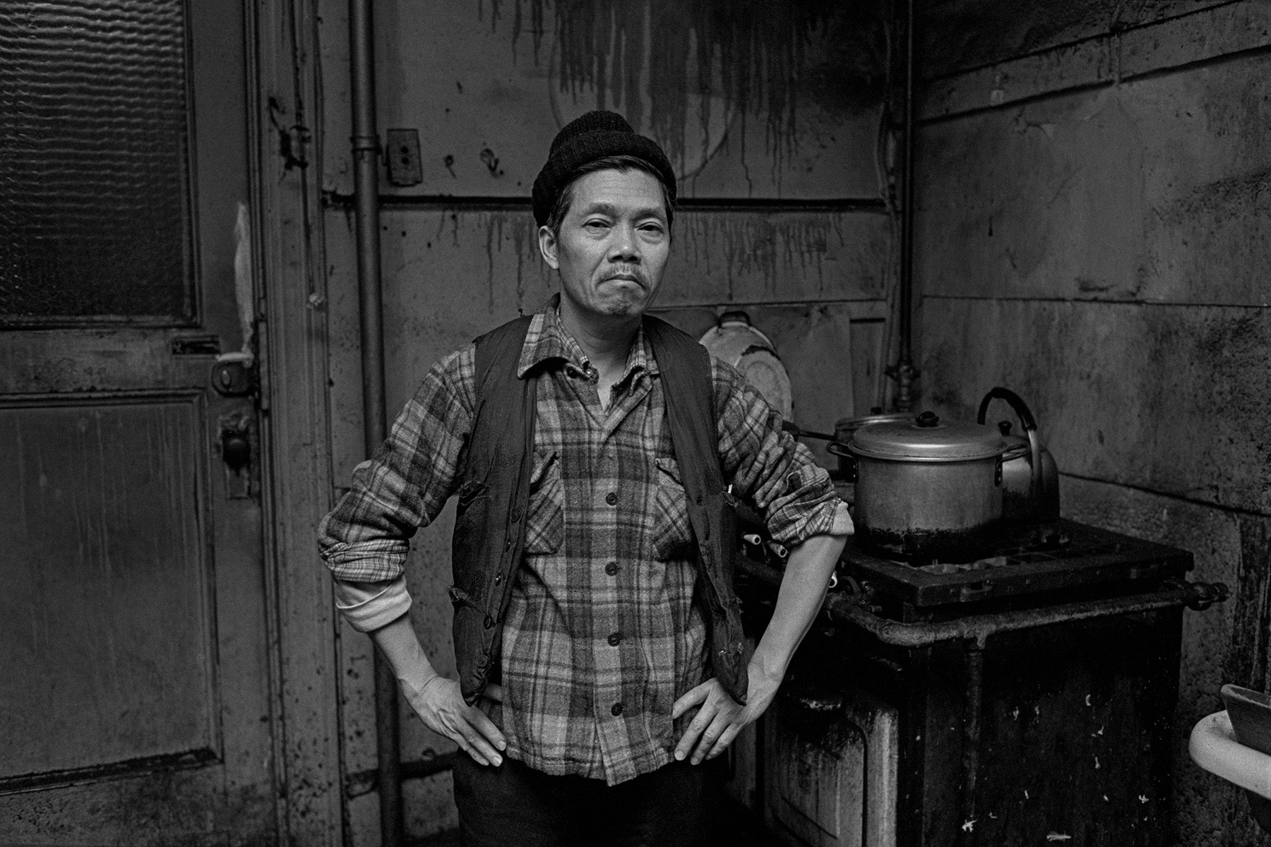 Portrait of a man in a Bachelor Apartment on Bayard St., New York Chinatown, 1982