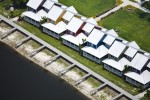 Lake Okeechobee, FLOwing to drought, the private docks of these new homes are no longer usable. As a side effect of water-level recession, the town of Okeechobee has also lost out on fishing tourism. In 2007, 1.9 million cubic yards of arsenic-laden mud was removed from the lake floor to reveal a more natural, sandy bottom, which should improve water clarity and habitability for plant and animal species.Ref #: 070604-0118