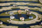 Galveston, TXHarborwalk is a planned waterfront community built on wetlands on the western coast of Galveston Bay. In the coming century this land will be some of the most vulnerable on the Texas coast to sea-level rise, yet developers continue to construct low-lying homes to cash in on waterfront property values.Ref #: 070630-0251