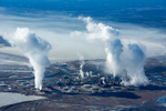 Rising steam and Smoke at the Syncrude Mildred Lake upgrade refinery, Mildred Lake, Canada 2014