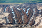 Muskeg, A Peat-Like, Moisture-Rich Soil, Must be Dewatered Before Open Pit Mining Can Begin, Alberta, Canada 2014