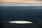 Natural Pond, Alberta, Canada 2014(Early morning mist lifting over the Boreal forest at sun rise)