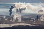 Steam and Smoke Rise from Upgrading Facility at Syncrude Mildred Lake Mine, Alberta, Canada 2014
