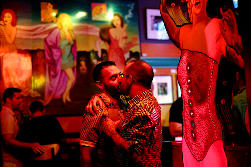 A couple embraces at Big Chicks, a gay-friendly nightclub in Chicago's Edgewater neighborhood on the far north side.