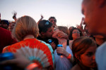 A couple finds intimacy in a crowd of thousands during Lollapalooza in Chicago's Grant Park.