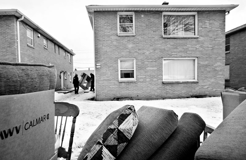 Employees of Eagle Moving and Storage Company pile the belongings of Shantana Smith, 26, after she was evicted from her apartment. Local residents know that when an Eagle truck shows up, a neighbor will be leaving soon.