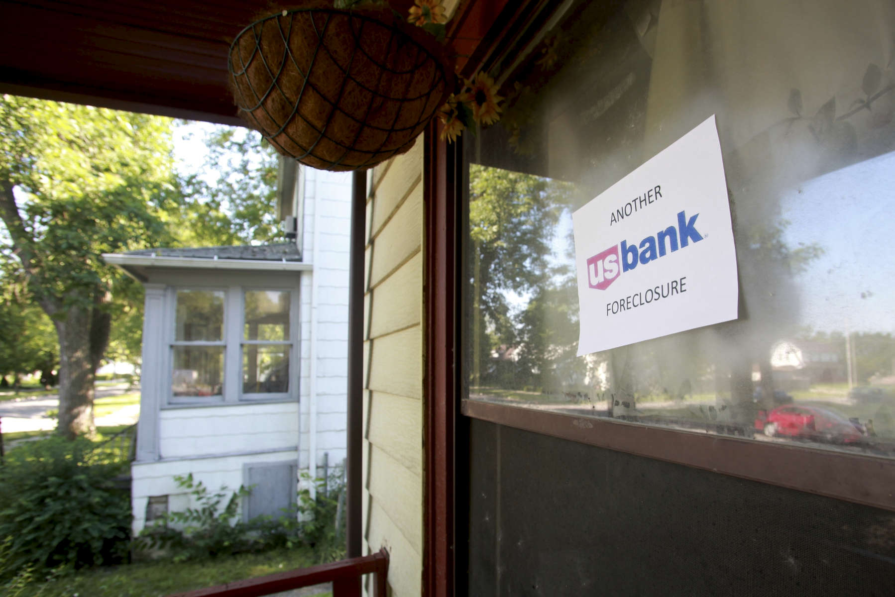 A sign posted on the front door denotes this foreclosed building as US Bank property. The bank inherited many foreclosed homes when it took over Park National Bank in January.