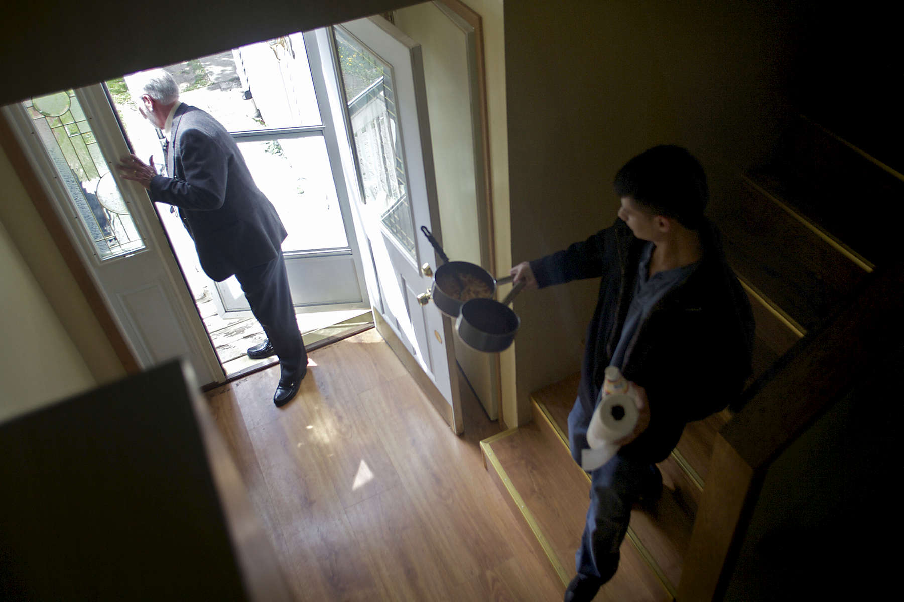 Realtor Joseph Laubinger, left, visits the Lopez home in suburban Chicago as they move out of the foreclosed property.