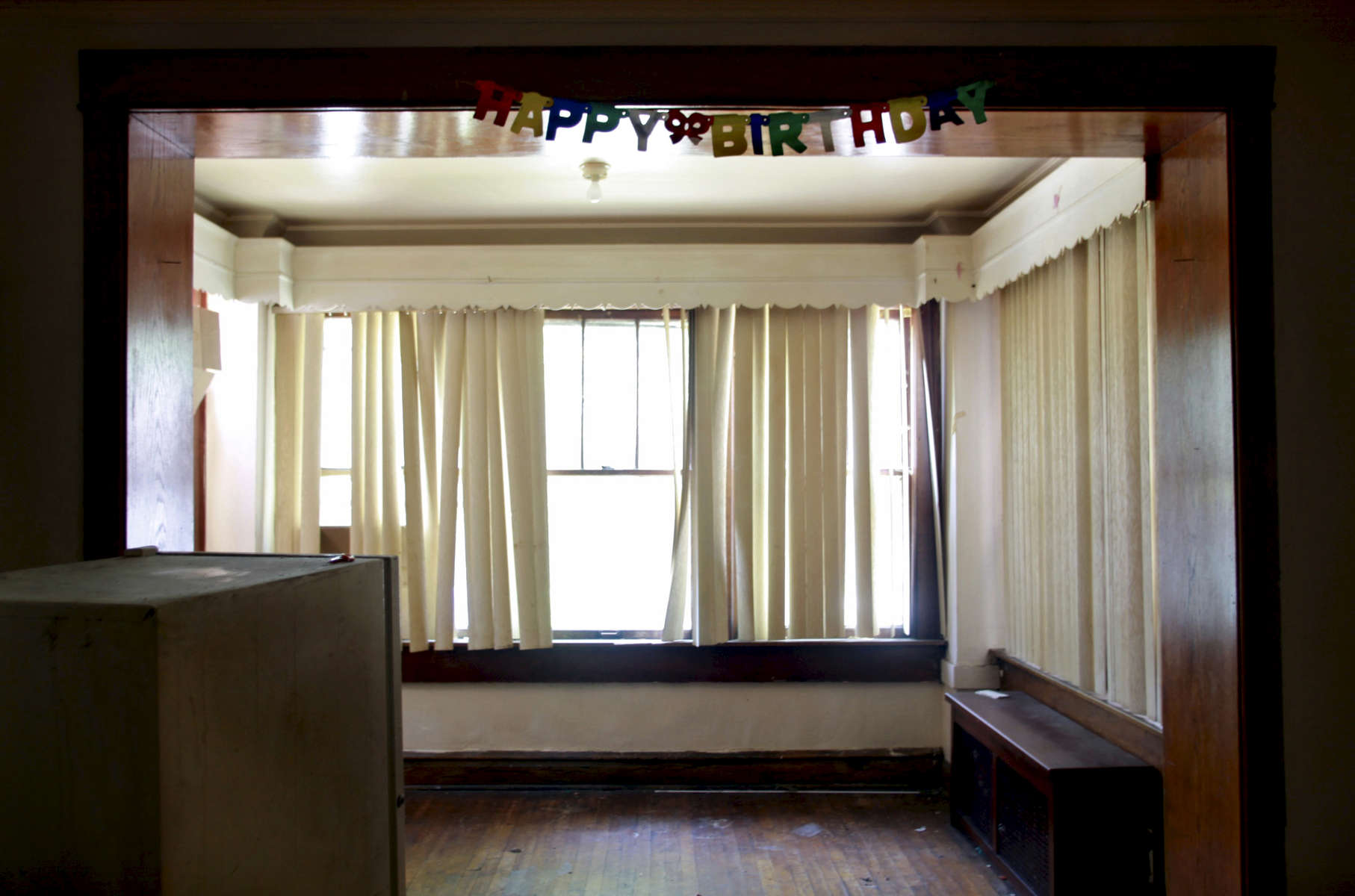 Birthday decorations still hang in the doorway between living and dining rooms in an apartment on Chicago's west side. The foreclosed building is property of US Bank, which inherited it and similar properties from Park National Bank earlier this year.