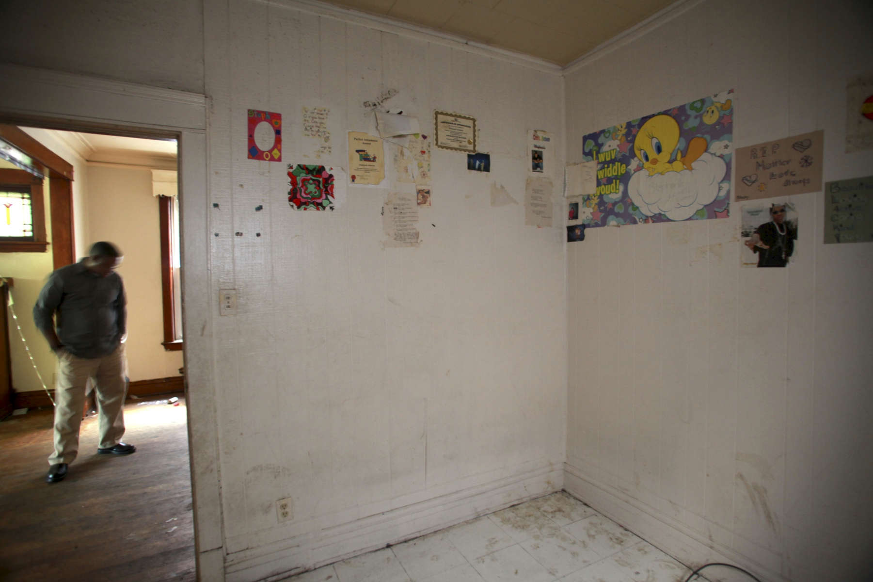 School awards, cards and photos still hang in a bedroom in an apartment on Chicago's west side. The foreclosed building is property of US Bank, which inherited it and similar properties from Park National Bank earlier this year.