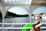 boat, water, green, inner tube, hat, straw hat, summer, tourist, archway