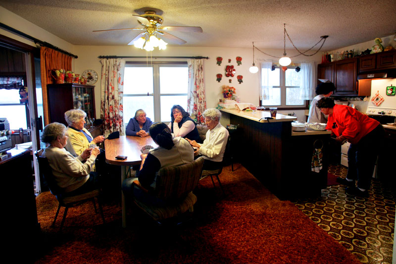 Marilyn Stewart, 78, far right, hosts a monthly game of six-hand euchre with a group of women who have been meeting for nearly 50 years in Oxford, Iowa.