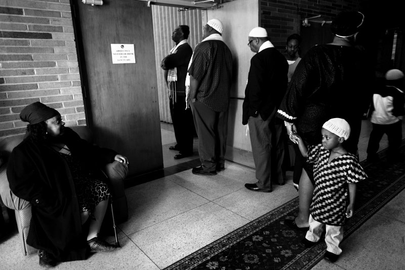 Members of Beth Shalom B'nai Zaken Ethiopian Hebrew Congregation wait to enter the sanctuary for Shabbat service.