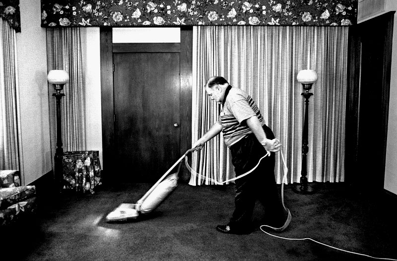 Bill Dunn cleans up after a funeral service at McKeown-Dunn Funeral Home in Oswego, Illinois, where he and his wife reside on the second floor. Located 46 miles west of Chicago, Oswego's small-town atmosphere is harder to find as the suburbs encroach on this rural community.