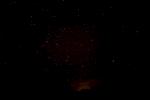 The lights of Presidio, Texas glow on the horizon near Highway 90, east of Marfa.