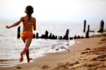 Kasadi Hallberg, 8, of Kodak, Tennessee chases a seagull along the beach in Ludington, Michigan. Hallberg was visiting family in Michigan during her summer vacation.