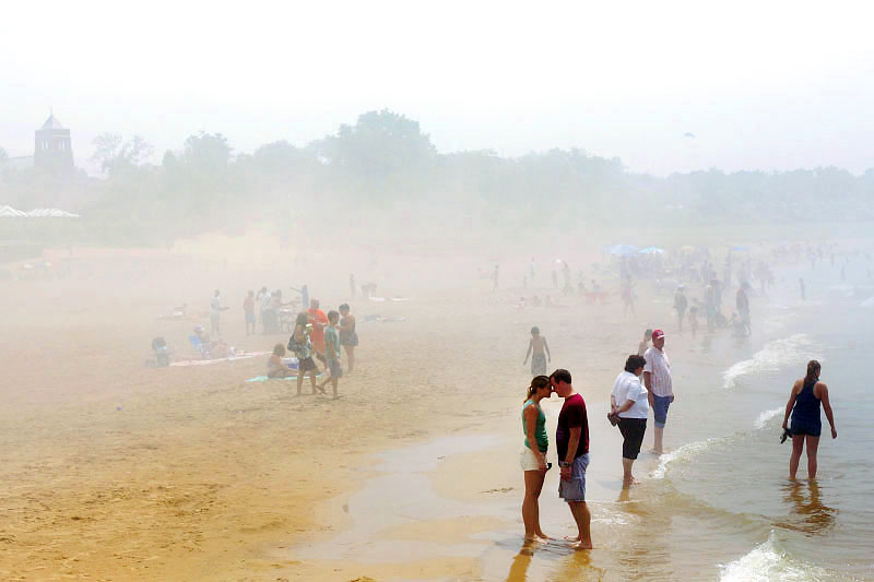 Fog overtakes beachgoers in South Haven, Michigan after a summer storm.