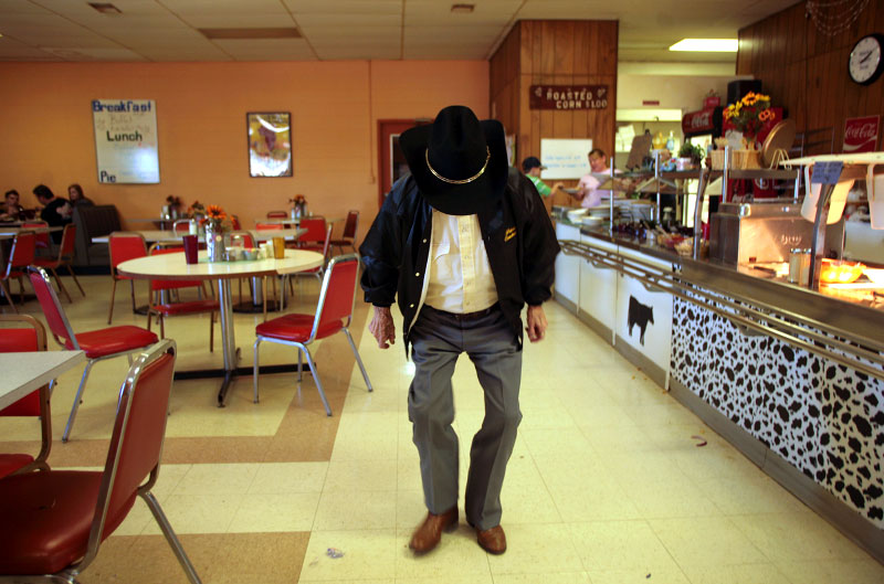 Grant W. Ponder, 95, a retired prison guard, showed off his dance steps at the Farmer's Cafe at the South Central Regional Stockyards in Vienna. Mr. Ponder said he will vote for Sen. Hillary Rodham Clinton because he likes women. A St. Louis Post-Dispatch poll of Democratic voters showed Mrs. Clinton leading the Democratic race with 44 percent of the vote.