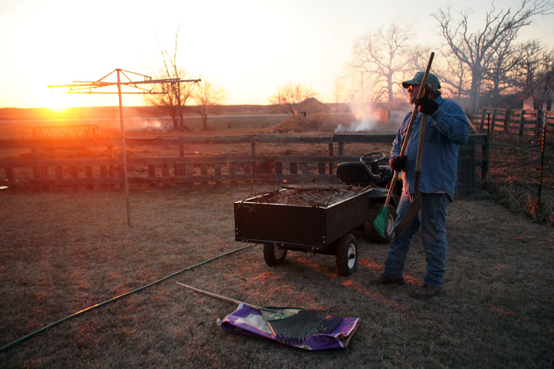 Les VanNote preps leaves for burning as the sun sets on the small town of Edgar Springs, Missouri. While some of his neighbors were unsure whether the nation is ready for Obama or Clinton as presidential candidates, VanNote has a philosophical attitude. {quote}I say, 'We shall see'.{quote}