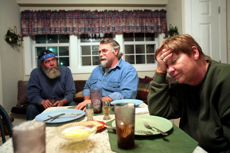 Les and Shirley VanNote, center and right, lean toward the Democrats in presidential elections, but they said they are more concerned about who is elected to Congress. Their neighbor Jim McFarland, left, joined them for dinner in their Edgar Springs home. McFarland frequently compared his appearance to that of forrmer Iraqi dictator Saddam Hussein when he was found hiding underground.