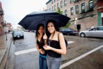 Two girls share an umbrella on a rainy day in Chicago's Pilsen neighborhood.