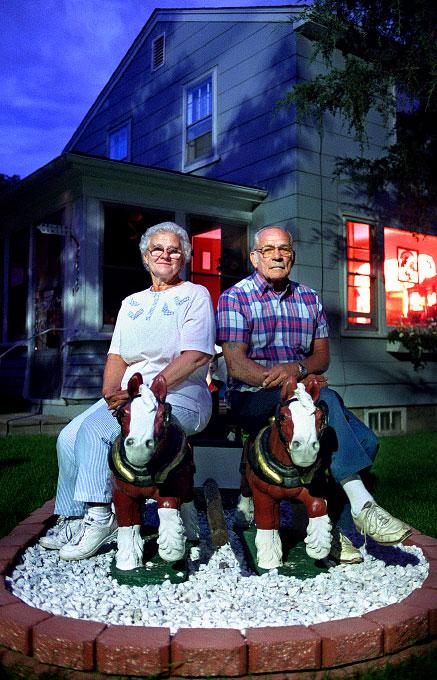 americana, night, horses, sculpture, wife, husband, front yard, blue sky, portrait