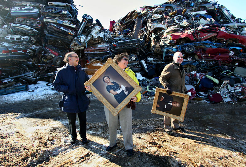 scrap, metal, picture frames, paintings, portraits, family, snow, dirt, sunny, pile, waste