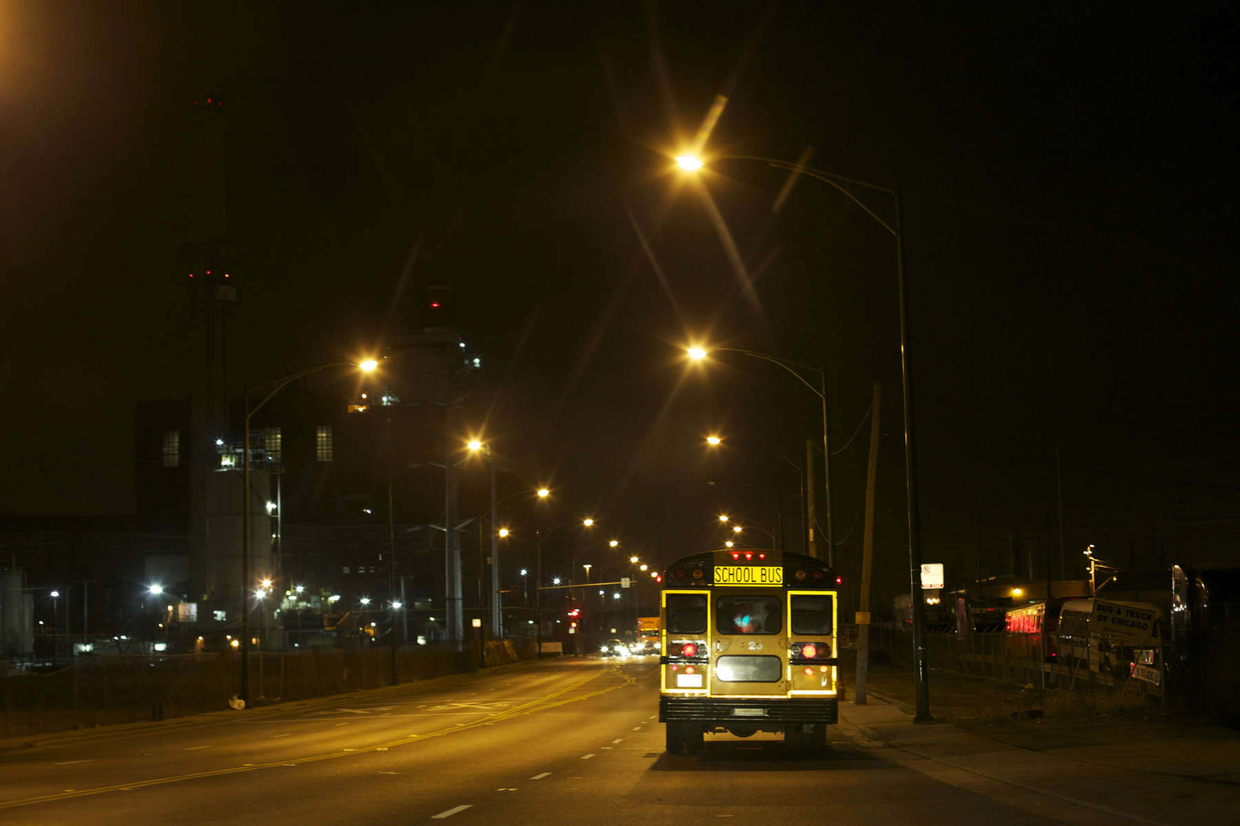 The bus carrying the temp workers heads south on Cicero Avenue in Chicago toward Interstate 55 at 5am. Their shifts will begin at 6am, and the workers will return home by bus or van.