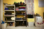 Upon her arrival in the United States, Rosa found full-time employment. But the past 12 years have only brought temporary work. Her belongings are organized along one wall of her room, next to a small refrigerator and microwave.