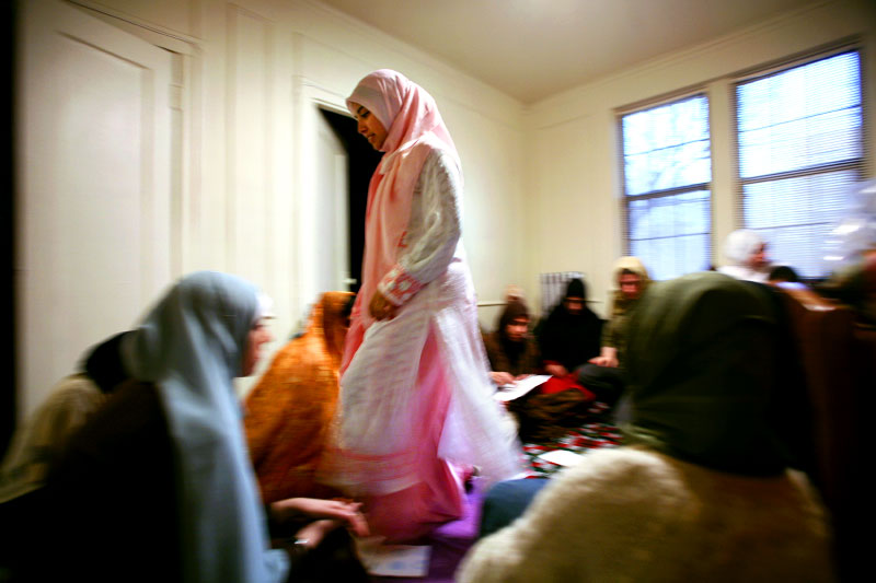 Sahar Ullah walks through a group of women during a Muslim prayer group near the University of Chicago.