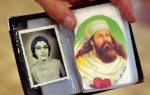 Edul Udvadia, 85, keeps a photo of his wife, Gool, next to the likeness of the Zoroastrian prophet, Zarathushtra in his wallet. Udvadia is a member of the Zoroastrian Association of Metropolitan Chicago and recently celebrated the annual fire ceremony that honors the dead.