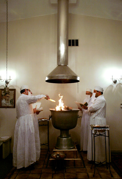 Priests surround the fire that emits a sandalwood scent and recite prayers during the fire ceremony at the Zoroastrian Association of Metropolitan Chicago.
