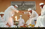 Zoroastrian priests perform a fire ceremony and prayers to honor the dead at the Zoroastrian Association of Metropolitan Chicago. Adherents to the ancient Persian religion are debating whether to accept converts or to recognize the children of mixed marriages as a way to boost the waning congregation numbers.