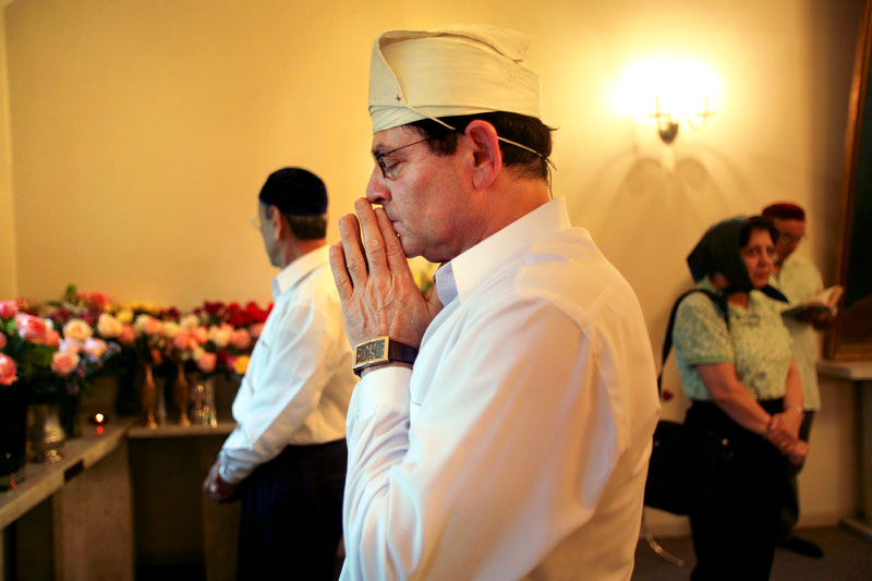 Inside the fire temple of the Zoroastrian Association of Metropolitan Chicago, Jamshed Ravji prays for the souls of loved ones who passed away.