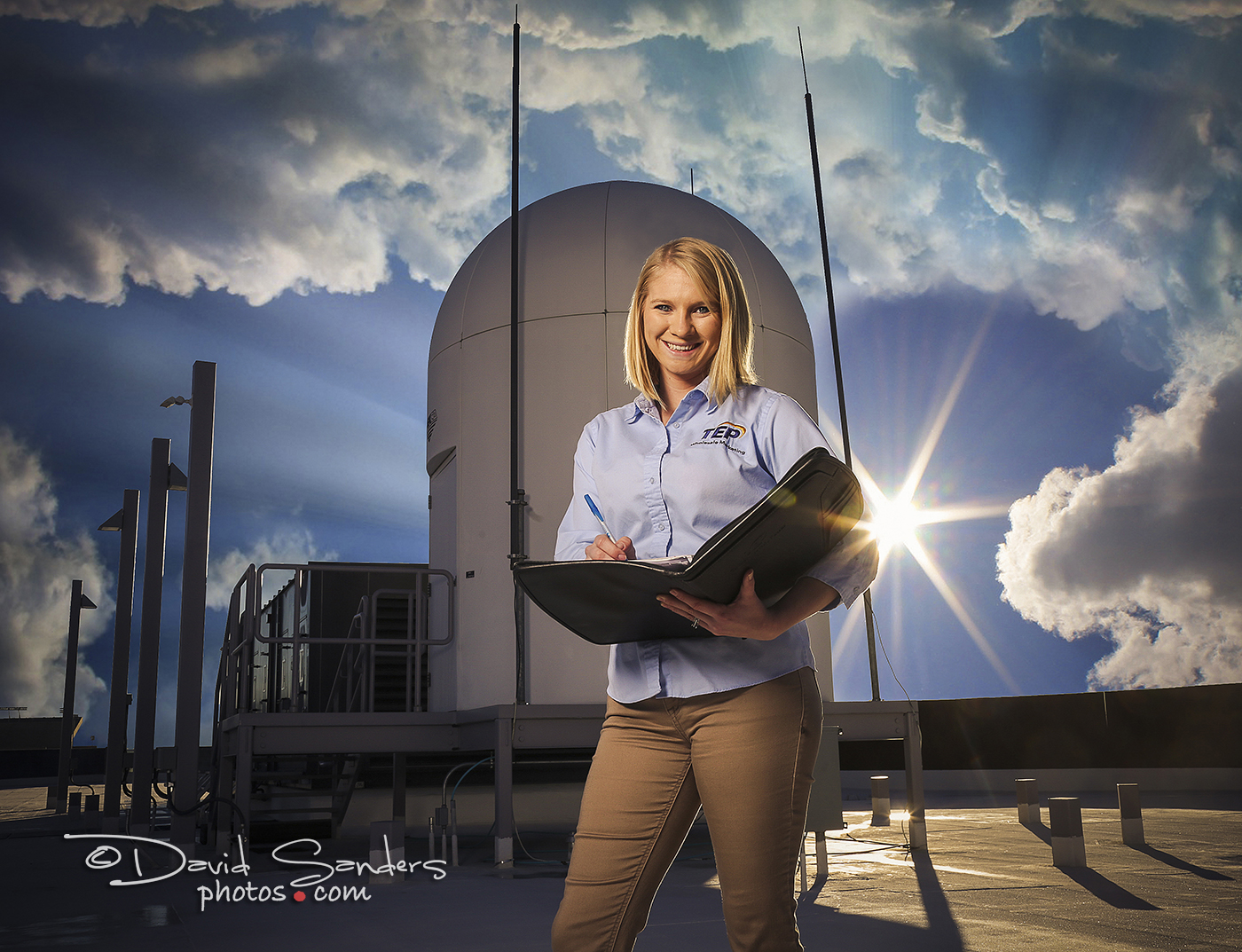 TEP Renewable Energy Forecasting/Trading Analyst Nicole Bell documents weather observations from equipment on the roof of the University of Arizona's ENR2 building.