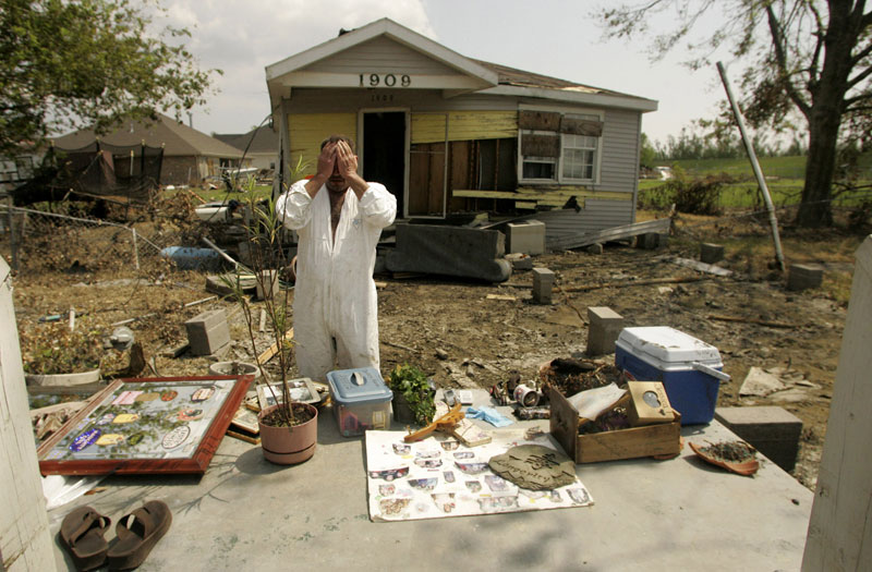 Steve Minyard stands in the place where his house once stood September 16, in Meraux, La.  Spread out on stoop are all the items which he could salvage from the wreckage left after the wind and flooding of Hurricane Katrina.  Among the keepsakes Minyard was especially intent on finding were pictures of his sister who died little over a year ago.  Minyard shared the house in St. Bernard Parish with his fiancee Jessica Marques Piazza and the two had returned Friday to gather their belongings.  {quote}To some people this doesn't seem like much,{quote} Piazza said.  {quote}But this is all I had.  All I had.{quote}  The couple does not have any insurance.