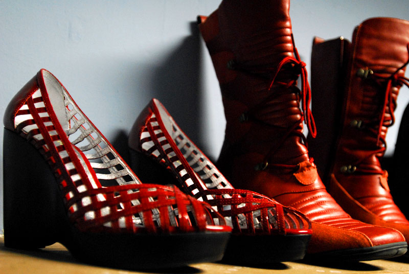 Red high heel shoes and red boots in Asbury Park, New Jersey. By photographer Adena Stevens