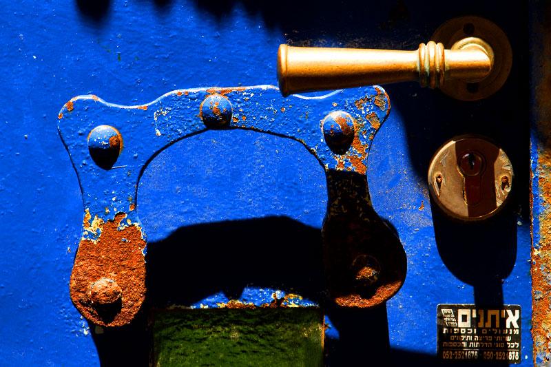 A blue door handle, Israel. By photographer Adena Stevens