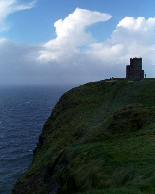 Ruins from a castle on a cliff at the Ring of Kerry, Ireland. By photographer Adena Stevens