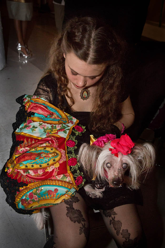 Nora is in a Virgin of Guadlupe themed gown by Anthony Rubio, waiting to go on the runnaway at Brooklyn Fashion Week.
