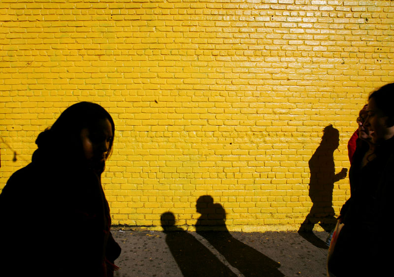A NYC East Village wall provides the backdrop: Witness shadow land, where the census depends on the time of day.