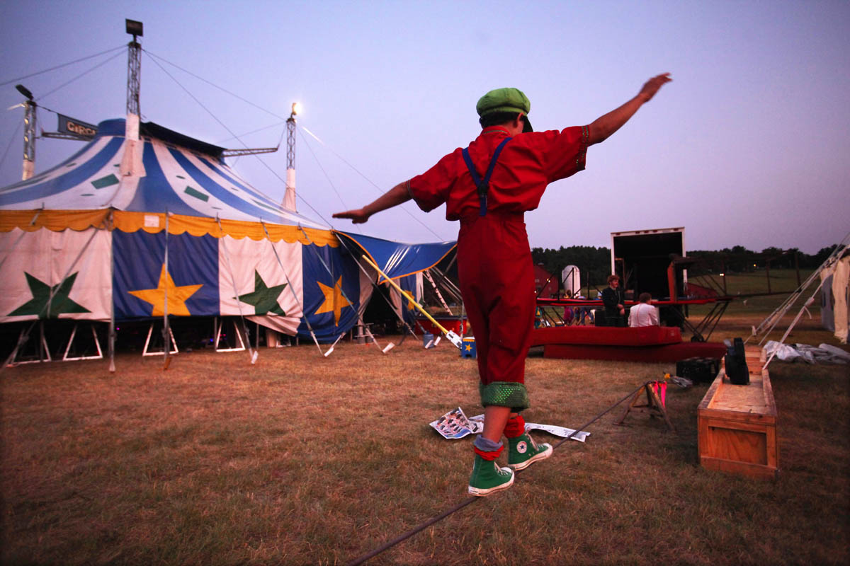 Vermont's International Youth Circus- Circus Smirkus 2011 Big Top Tour, performs in Brattleboro, VT, pitching their tents in a field at the Vermont Agricultural Business and Education Center. 14 year old trouper, Sam Ferlo from Rome, NY, who plays a clown just as his father did for Ringling Brothers Circus. His father passed away in November of last year and Sam has decided to follow in his father's footsteps. Friends of the family and circus performers donated money to an education fund so that Sam could attend the circus camp.