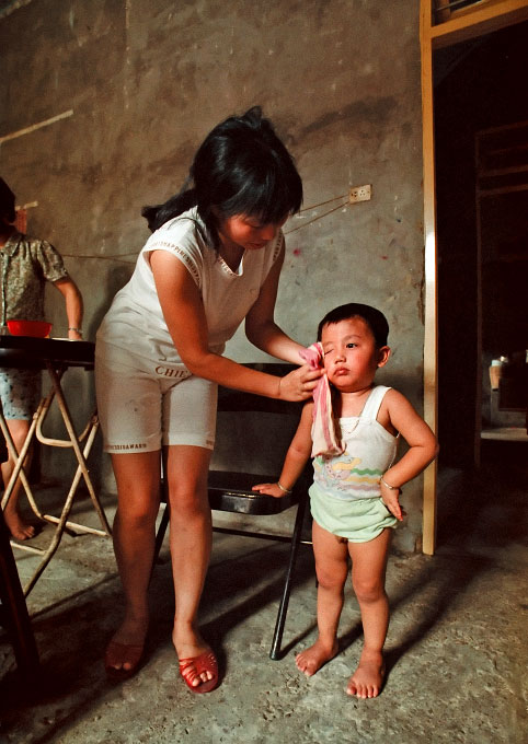 A young wife and mother at home in Fuzhou China, cares for her son and waits to hear the fate of her husband. He ended-up in a U.S. detention center after the ship he was smuggled in on went adrift off of the shore of Queens, NY.